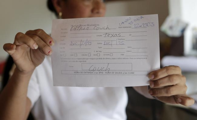 A Los Tules hotel staff member shows a registration form for the rooms where Ethan Couch, 18, and his mother, Tonya Couch, stayed for five days (Dec. 20-25) in the Pacific beach resort of Puerto V ...