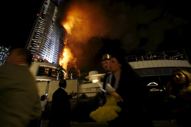 People run away as a fire engulfs The Address Hotel in downtown Dubai in the United Arab Emirates December 31, 2015. (Ahmed Jadallah/Reuters)