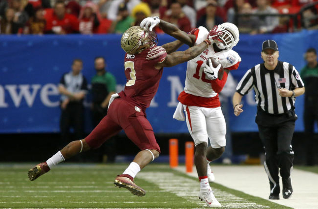 Dec 31, 2015; Atlanta, GA, USA; Houston Cougars wide receiver Demarcus Ayers (10) is pushed out of bounds by Florida State Seminoles defensive back Derwin James (3) in the second quarter of the 20 ...