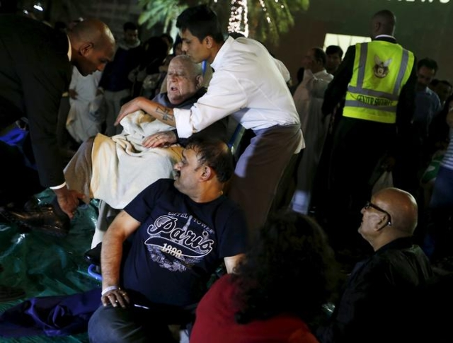 Wounded people are seen outside the Address Downtown Dubai hotel and residential block after a fire engulfed the skyscraper in downtown Dubai in the United Arab Emirates December 31, 2015. (Ahmed  ...