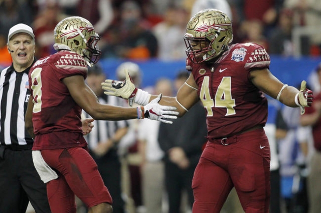 Dec 31, 2015; Atlanta, GA, USA; Florida State Seminoles defensive back Jalen Ramsey (8) celebrates with defensive end DeMarcus Walker (44) against the Houston Cougars in the third quarter in the 2 ...
