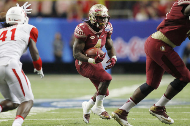 Dec 31, 2015; Atlanta, GA, USA; Florida State Seminoles running back Dalvin Cook (4) carries the ball against the Houston Cougars in the third quarter in the 2015 Chick-fil-A Peach Bowl at the Geo ...