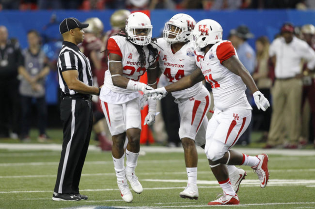 Dec 31, 2015; Atlanta, GA, USA; Houston Cougars safety Trevon Stewart (23) celebrates with teammates after an interception against the Florida State Seminoles in the third quarter in the 2015 Chic ...