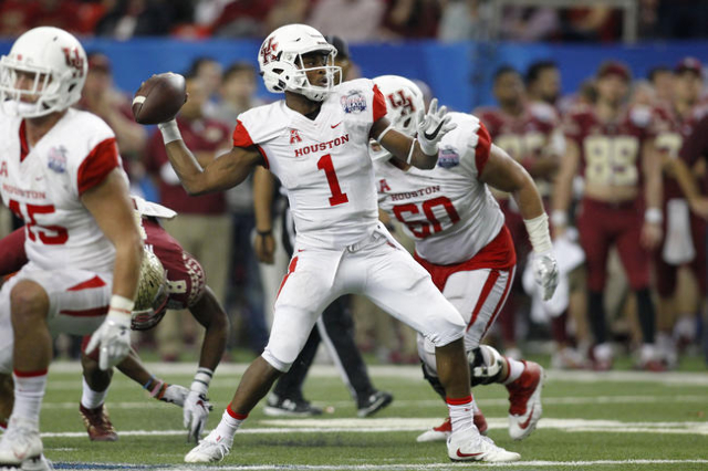 Dec 31, 2015; Atlanta, GA, USA; Houston Cougars quarterback Greg Ward Jr. (1) throws the ball against the Florida State Seminoles in the fourth quarter in the 2015 Chick-fil-A Peach Bowl at the Ge ...