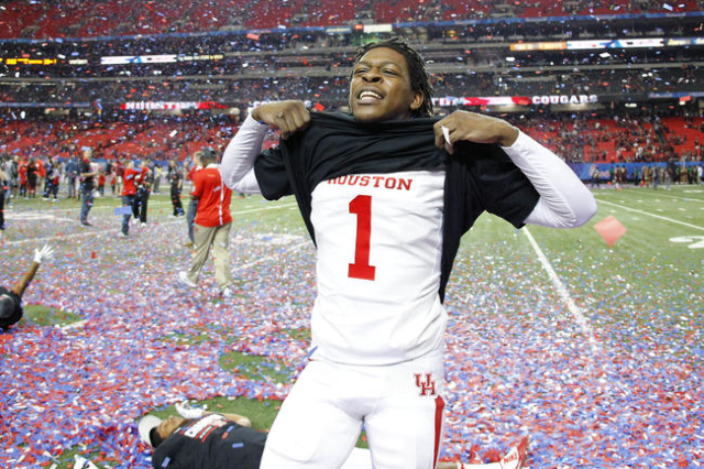 Dec 31, 2015; Atlanta, GA, USA; Houston Cougars safety Garrett Davis (1) celebrates after defeating the Florida State Seminoles 38-24 in the 2015 Chick-fil-A Peach Bowl at the Georgia Dome. Mandat ...