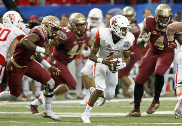 Dec 31, 2015; Atlanta, GA, USA; Houston Cougars quarterback Greg Ward Jr. (1) runs with the ball against the Florida State Seminoles in the third quarter of the 2015 Chick-fil-A Peach Bowl at the  ...