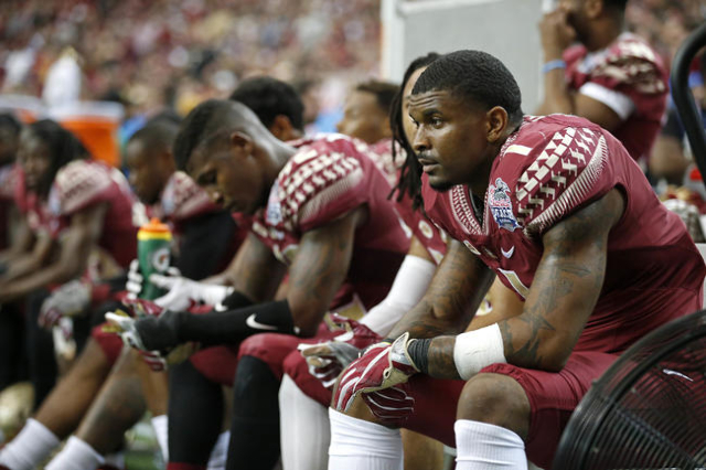 Dec 31, 2015; Atlanta, GA, USA; Florida State Seminoles defensive back Tyler Hunter (1) and teammates sit on the bench in the fourth quarter against the Houston Cougars during the 2015 Chick-fil-A ...