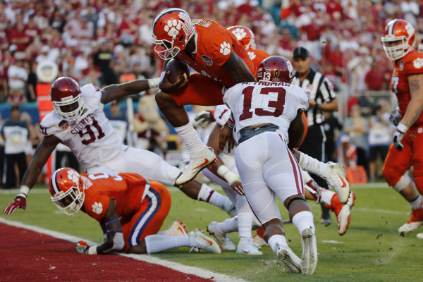 Dec 31, 2015; Miami Gardens, FL, USA;Clemson Tigers quarterback Deshaun Watson (4) runs the ball for a touchdown against Oklahoma Sooners safety Ahmad Thomas (13) in the second quarter of the 2015 ...