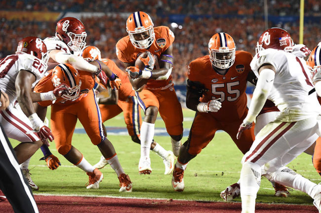 Dec 31, 2015; Miami Gardens, FL, USA; Clemson Tigers running back Wayne Gallman (9) runs in to the end zone to score a touchdown against the Oklahoma Sooners in the third quarter of the 2015 CFP S ...