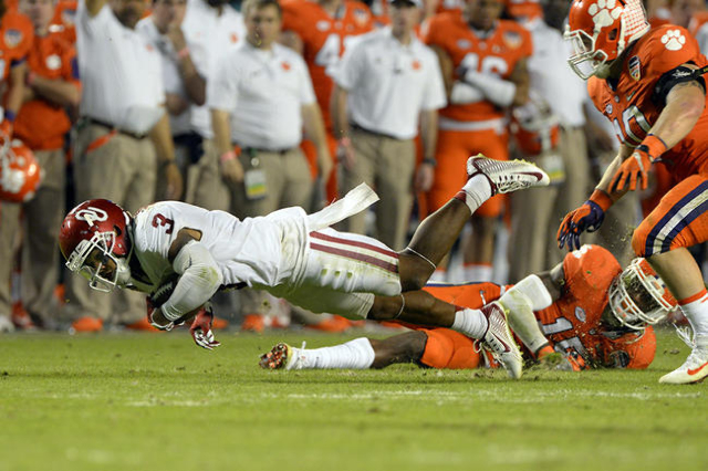 Dec 31, 2015; Miami Gardens, FL, USA; Oklahoma Sooners wide receiver Sterling Shepard (3) is brought down by Clemson Tigers safety T.J. Green (15) during the third quarter of the 2015 CFP semifina ...
