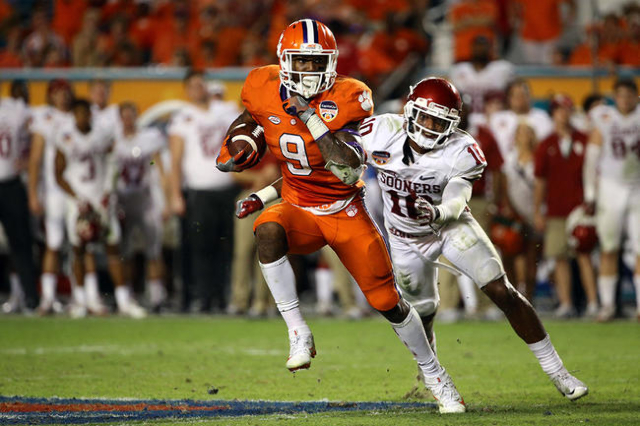 Dec 31, 2015; Miami Gardens, FL, USA; Clemson Tigers running back Wayne Gallman (9) runs against Oklahoma Sooners safety Steven Parker (10) during the fourth quarter of the 2015 CFP semifinal at t ...