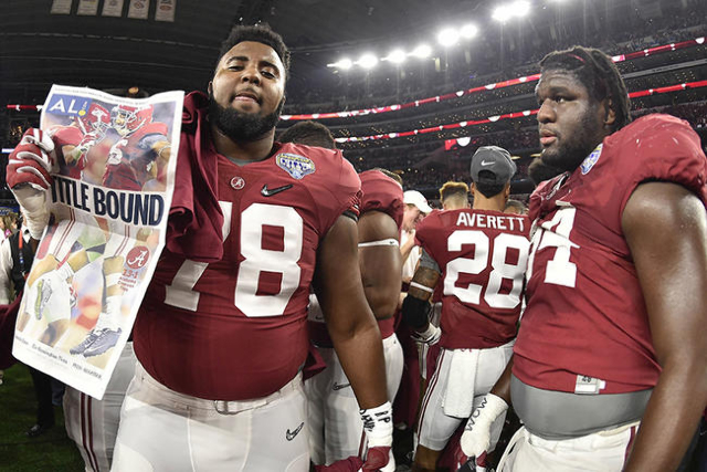 Dec 31, 2015; Arlington, TX, USA; Alabama Crimson Tide offensive lineman Korren Kirven (78) holds up a paper after the game against the Michigan State Spartans in the 2015 CFP semifinal at the Cot ...