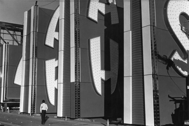 """A man is seen in front of parts of a new Sahara sign, installed in 1986, that the Young Electric Sign Co. claimed would be the """"tallest free-standing sign in the world,"""" in this undated  ..."""