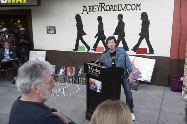 """Promoter Paul Casey speaks during a gathering at the """"Abbey Road Crossing"""" on Fremont Street on the 35th anniversary of John Lennon's murder Tuesday,  Dec. 8, 2015. (Sam Morris/Las ..."""