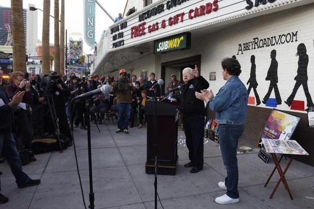 """City Councilman Bob Coffin speaks during a gathering at the """"Abbey Road Crossing"""" on Fremont Street on the 35th anniversary of John Lennon's murder Tuesday,  Dec. 8, 2015. (Sam Mor ..."""