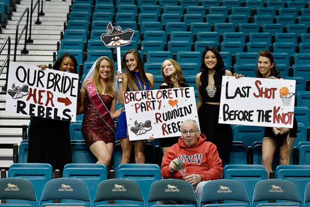 Rebel fan and soon-to-be bride Ally Baker, second from left, poses with her friends, from left, Meliscia Gilbert, Emily O'Rourke, Heather Schenck, Ann Lim and Sara Ross before the UNLV baske ...
