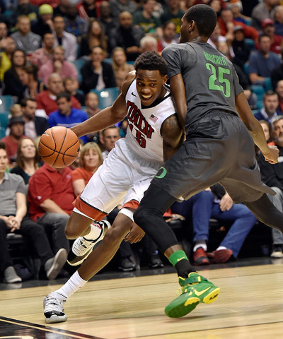 UNLV forward Dwayne Morgan (15) drives the ball against Oregon's Chris Boucher during an NCAA college basketball game at the MGM Grand Garden Arena on Friday, Dec. 4, 2015, in Las Vegas. (Da ...