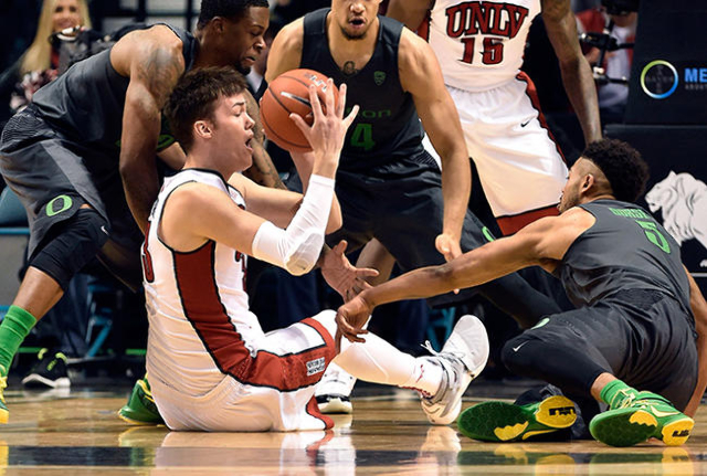 UNLV forward Stephen Zimmerman Jr. (33) picks up a loose ball against Oregon during an NCAA college basketball game at the MGM Grand Garden Arena on Friday, Dec. 4, 2015, in Las Vegas. (David Beck ...