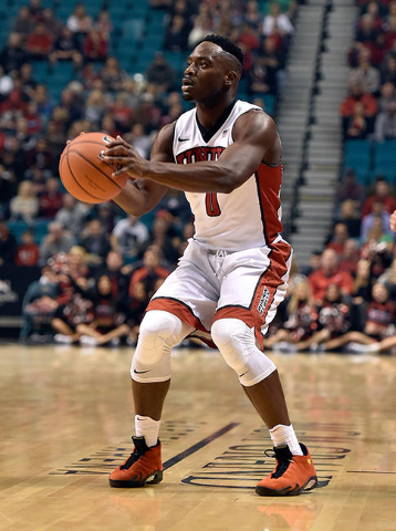 UNLV guard Ike Nwamu (0) looks to shoot a three-point basket against Oregon during an NCAA college basketball game at the MGM Grand Garden Arena on Friday, Dec. 4, 2015, in Las Vegas. (David Becke ...