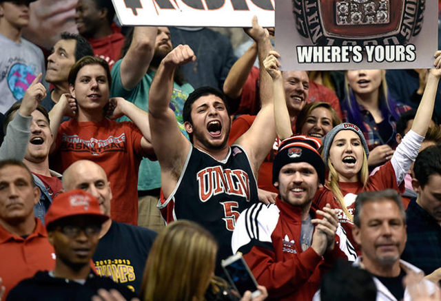 UNLV Student Matthew Peskin, center, cheers for the UNLV Rebels as they played Oregon during an NCAA college basketball game at the MGM Grand Garden Arena on Friday, Dec. 4, 2015, in Las Vegas. UN ...