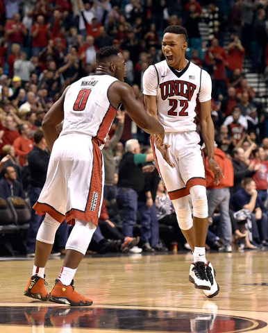 UNLV guards Ike Nwamu (0) and Patrick McCaw react after during an NCAA college basketball game against Oregon at the MGM Grand Garden Arena on Friday, Dec. 4, 2015, in Las Vegas. UNLV won 80-69. ( ...