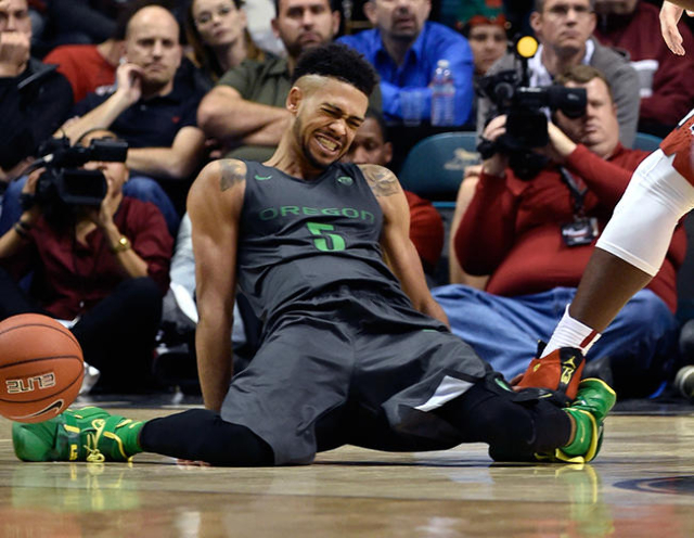 Oregon's Tyler Dorsey (5) splays his legs out as he falls to the court during an NCAA college basketball game against  UNLV at the MGM Grand Garden Arena on Friday, Dec. 4, 2015, in Las Vega ...