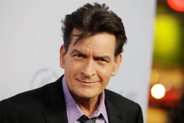 "Cast member Charlie Sheen poses at the premiere of his new film ""Scary Movie 5"" in Hollywood, April 11, 2013. (Fred Prouser/Reuters/Files)"