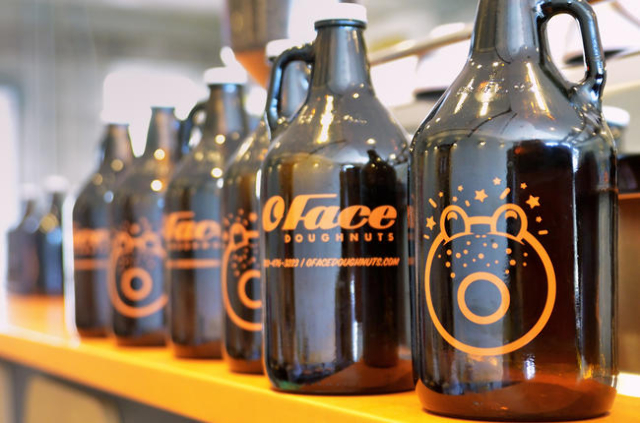 One-half gallon jugs known as growlers, used for those who want to take a bunch of cold-brewed coffee home, are shown at O Face Doughnuts on the Carson Avenue side of the John E. Carson Building a ...
