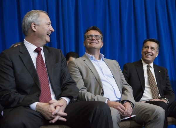 Steve Hill, director of the Governor's Office of Economic Development, Dag Reckhorn, global vice president for Faraday Future and Gov. Brian Sandoval share a laugh during the Faraday's develop ...