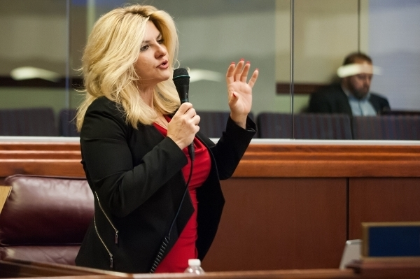 Assemblywoman Michele Fiore, R-Las Vegas, urges lawmakers to support Senate Bill 1 at the Legislative Building in Carson City, Nev., on Saturday, Dec. 19, 2015. The Assembly approved the measure 3 ...