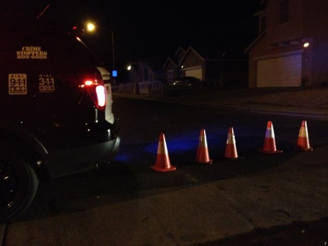 Police block access to Idlewood Avenue as they investigate the scene of an officer-involved shooting on Monday, Dec. 14, 2015. The neighborhood is southwest of Lamb Boulevard and Alexander Road in ...