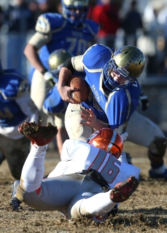 Bishop Gorman's Haskell Garrett sacks Reed quarterback Matt Denn in an NIAA Division I playoff game at Reed High School in Sparks, Nev., on Saturday, Nov. 28, 2015. Bishop Gorman won 41-13.  ...