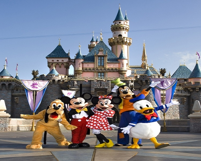 The classic Disney characters welcome visitors outside Sleeping Beauty Castle at Disneyland in Anaheim, Calif.: Pluto, Mickey Mouse, Minnie Mouse, Goofy and Donald Duck.