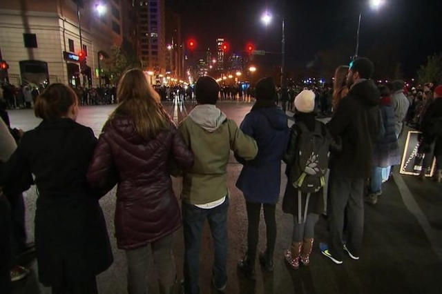 Demonstrators take to the streets in protest after the release of video showing the 2014 shooting death of Laquan McDonald by a Chicago police officer (CNN)