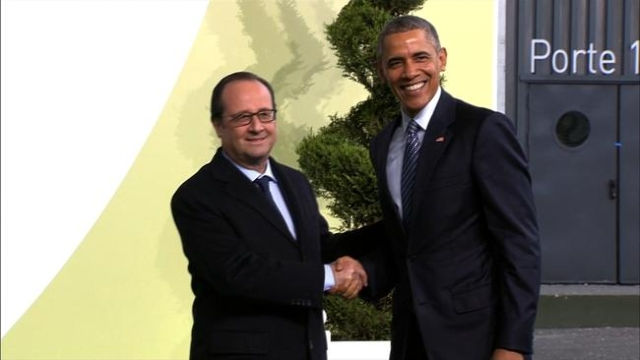 President Barack Obama arrives in France and is greeted by French President Francois Hollande.
