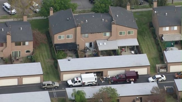 Investigators work on Dec. 3, 2015, at a Redlands home rented by the couple who opened fire in San Bernardino the previous day. (CNN)