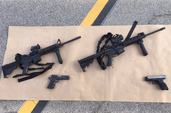 Photos from the scene of the officer involved shooting. Weapons & ammunition carried by the suspects.