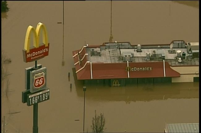 Flood waters cover businesses over Union, Missouri on Tuesday. (KTVI/CNN)