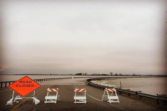 Route 67, which crosses from Missouri into Illinois, has been closed since the Mississippi River inundated it earlier this week.  Woodworker David Stine captured this image Wednesday in West Alton ...