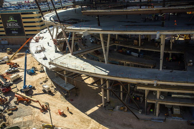 Construction at the MGM Resorts International-AEG arena construction site behind New York-New York casino-hotel is seen Monday, March 30, 2015. The $375 million arena is scheduled to open in April ...