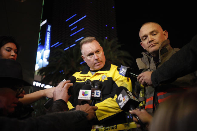 Metro Capt. Peter Bofelli briefs the media about a crash on the Strip in Las Vegas that left one person dead and 37 injured after a car plowed into a group of pedestrians the evening of Sunday, De ...