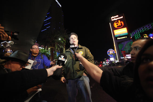 Metro Deputy Chief Brett Zimmerman briefs the media about a crash on the Strip in Las Vegas that left one person dead and 37 injured after a car plowed into a group of pedestrians the evening of S ...