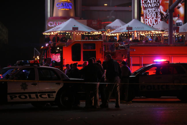 Police investigate the scene of a crash on the Strip in Las Vegas that left one person dead and 37 injured after a car plowed into a group of pedestrians the evening of Sunday, Dec. 20, 2015. Rach ...