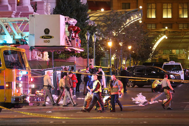 Police investigate the scene of a crash on the Strip in Las Vegas that left one person dead and 37 injured after a car plowed into a group of pedestrians Sunday, Dec. 20, 2015. (Rachel Aston/Las V ...