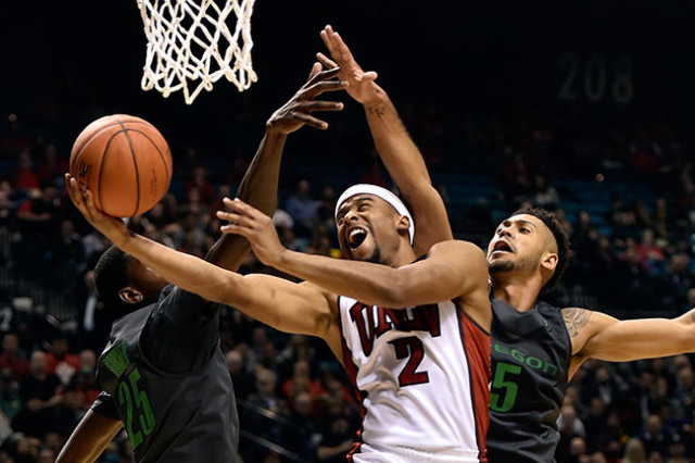 UNLV guard Jerome Seagears (2) shoots against Oregon's Chris Boucher (25) and Tyler Dorsey during an NCAA college basketball game at the MGM Grand Garden Arena on Friday, Dec. 4, 2015, in La ...