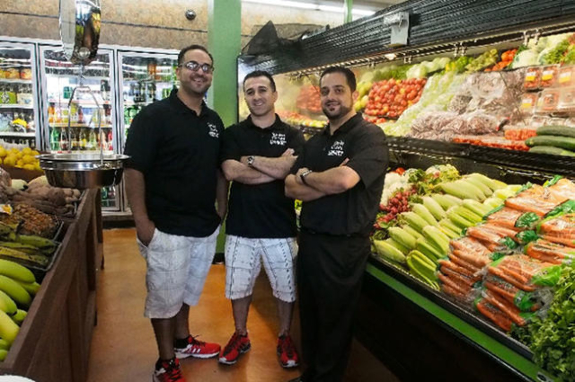 Owners Jimmy Shoshani, left, Rimon Hirmiz and Nick Shoshani stand in the produce area at the new White Cross Market just before its reopening in July 2013. (Las Vegas Review-Journal file)