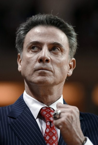 Louisville coach Rick Pitino looks up at the scoreboard during an NCAA college basketball game against College of Charleston during the first half of an NCAA college basketball game in Charleston, ...