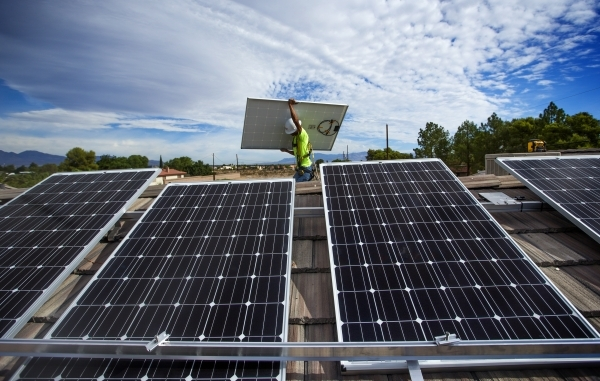 Justin Henderson  with Robco Electric installs solar panels on a home in southwest Las Vegas on Wednesday, Aug. 5, 2015. JEFF SCHEID/LAS VEGAS REVIEW-JOURNAL FOLLOW HIM @JLSCHEID °