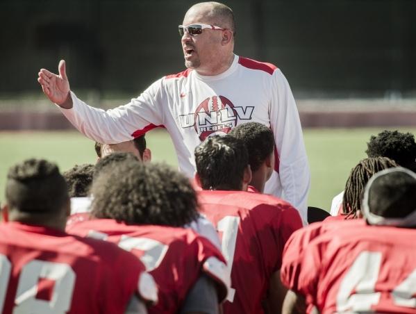 UNLV Men's football coach Tony Sanchez talks to players at the end of practice at Rebel Park on Monday, Aug. 10, 2015.JEFF SCHEID/LAS VEGAS REVIEW-JOURNAL Follow him @jlscheid