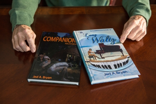 Mormon author Jed Bryan shows copies of his books in his home office in Henderson on Thursday, Nov. 19, 2015. Bryan also designed the covers. Donavon Lockett/Las Vegas Review-Journal